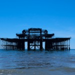 A kayak sails past the remains of the West Pier, Brighton