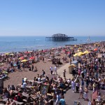 Brighton Beach with the burnt out West Pier in the background